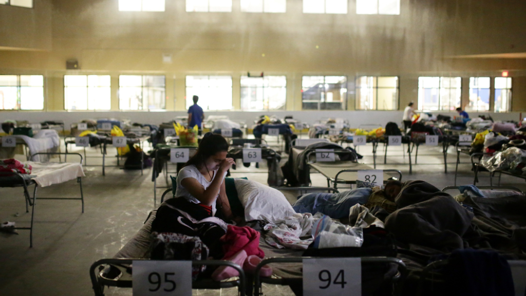 Thousands of people are sheltering in evacuation centres. (AFP)