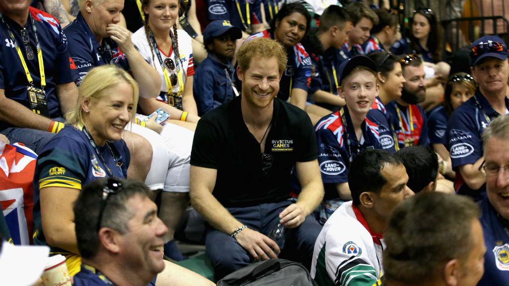 Prince Harry with Australian team and the crowd during the sit-down volleyball. (Chris Jackson/Getty/AFP)
