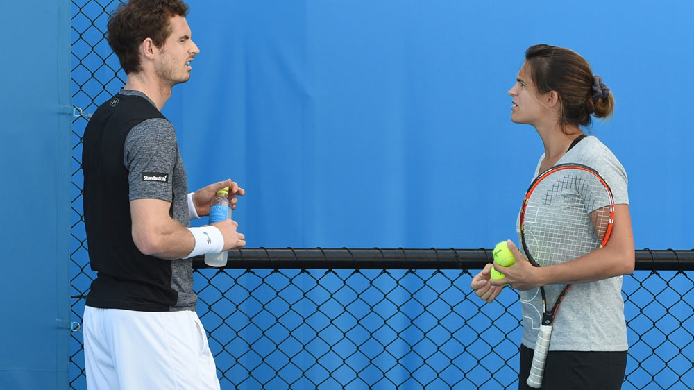 Andy Murray (L) and Amelie Mauresmo chat during a training session. (AFP)