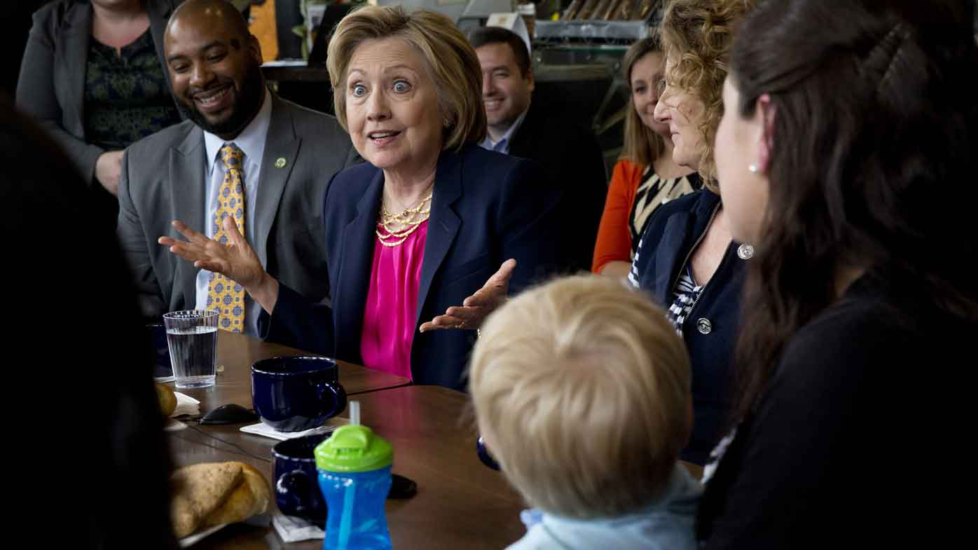 Hillary Clinton speaks to supporters at a cafe in Virginia. (AAP)