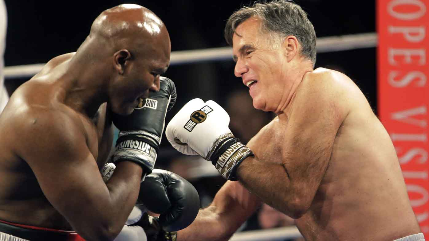 Mitt Romney takes on Evander Holyfield in a charity fight. (AAP)