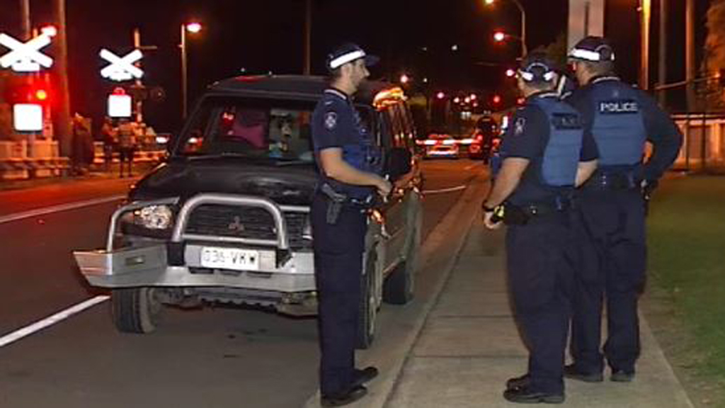 It's believed the man was hit after he ran around a lowered boom gate while being chased. (9NEWS)
