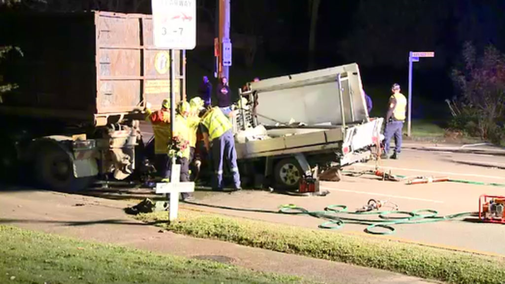 Driver rescued after becoming wedged under garbage truck in Sydney's south