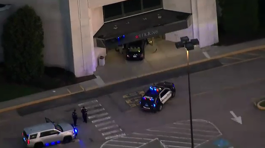 The suspect crashed a car into the entrance of a department store. (ABC News)