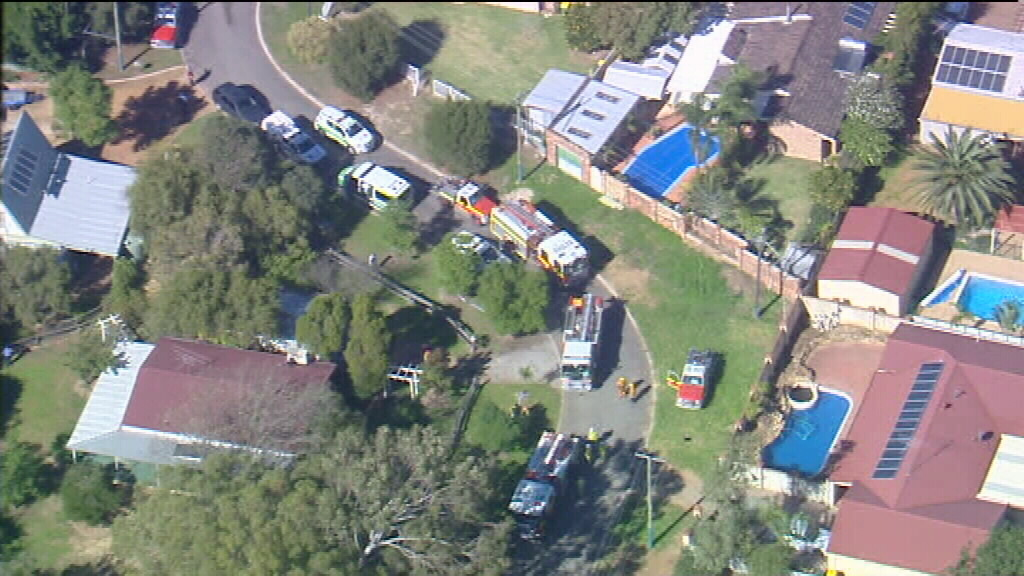The woman died in the driveway of the home. (9NEWS)