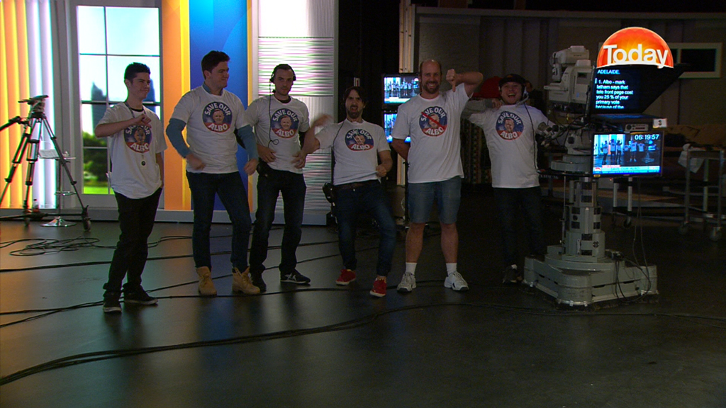 Members of the TODAY show crew wearing the 'Save our Albo' T-shirts. (9NEWS)