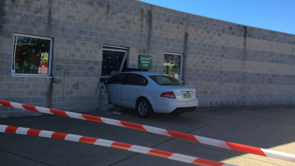 Car crashes through concrete wall of Sydney crèche, injuring worker
