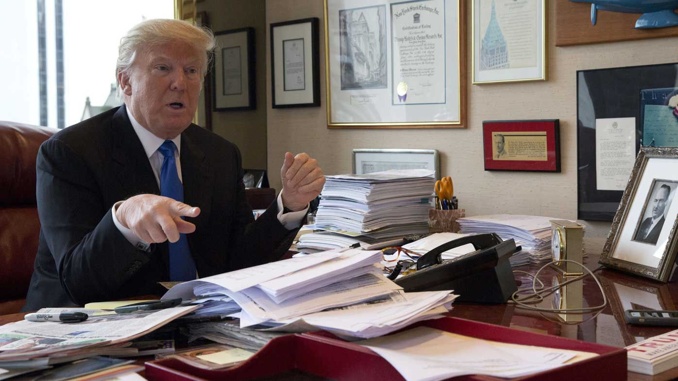 Donald Trump in his office. (AAP)