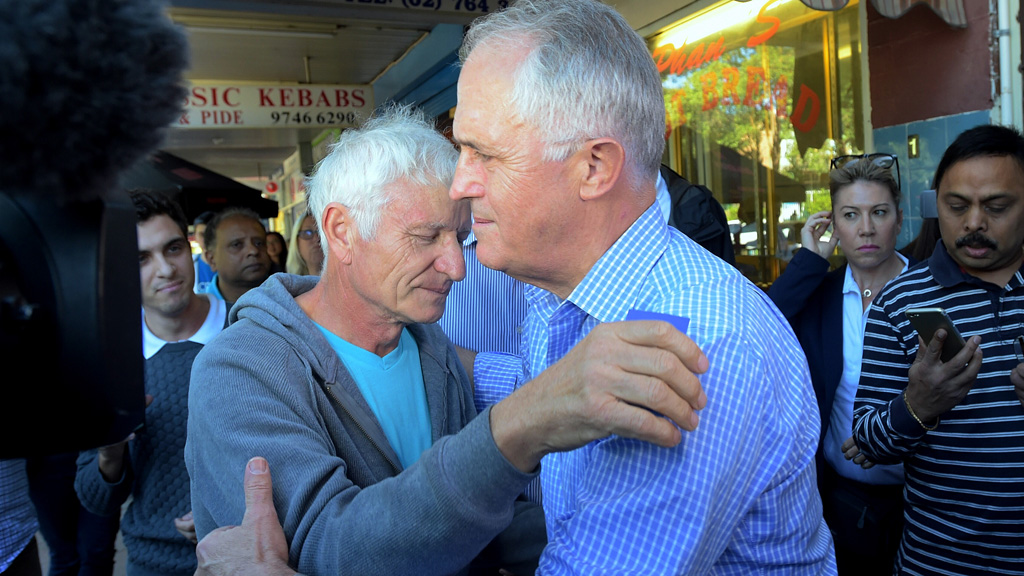 Prime Minister Malcolm Turnbull embraces father of MH17 victim
