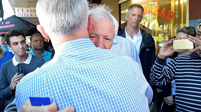 PM embraces MH17 victim's father