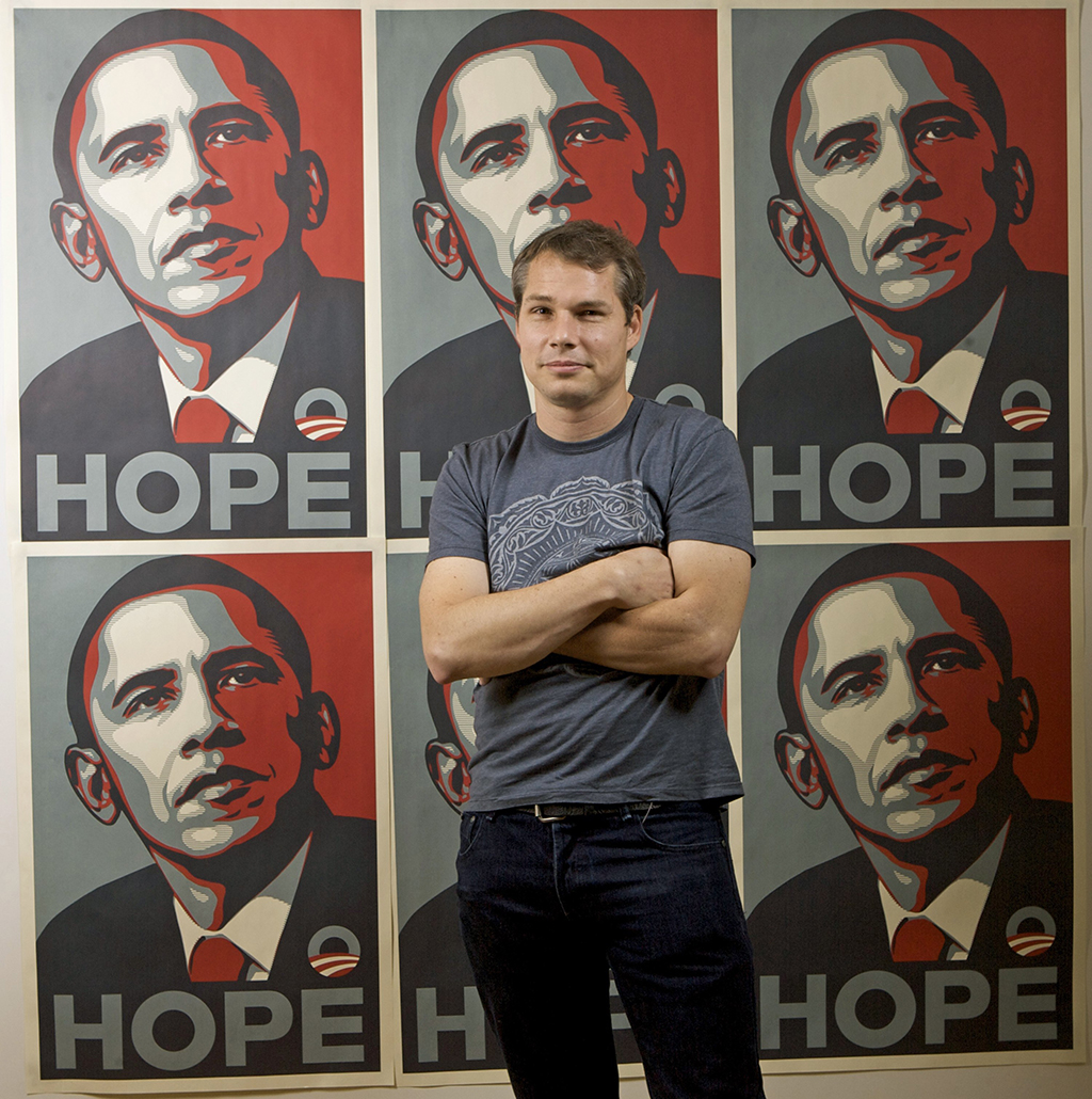 Los Angeles street artist Shepard Fairey poses for a picture with his Barack Obama Hope artwork. (AAP)