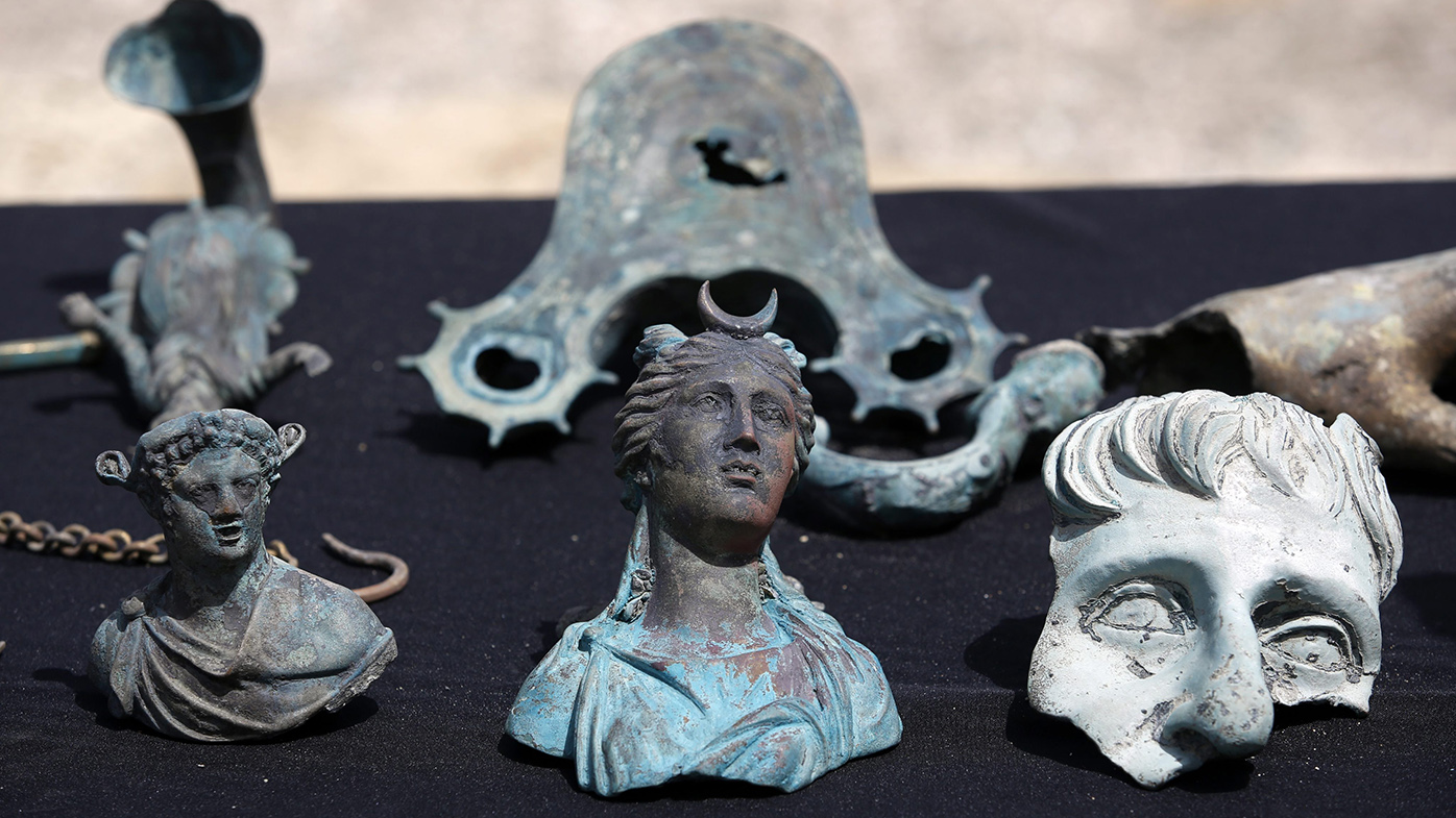Some of the archeological finds are on display at the ancient port of Caesarea. (AAP)