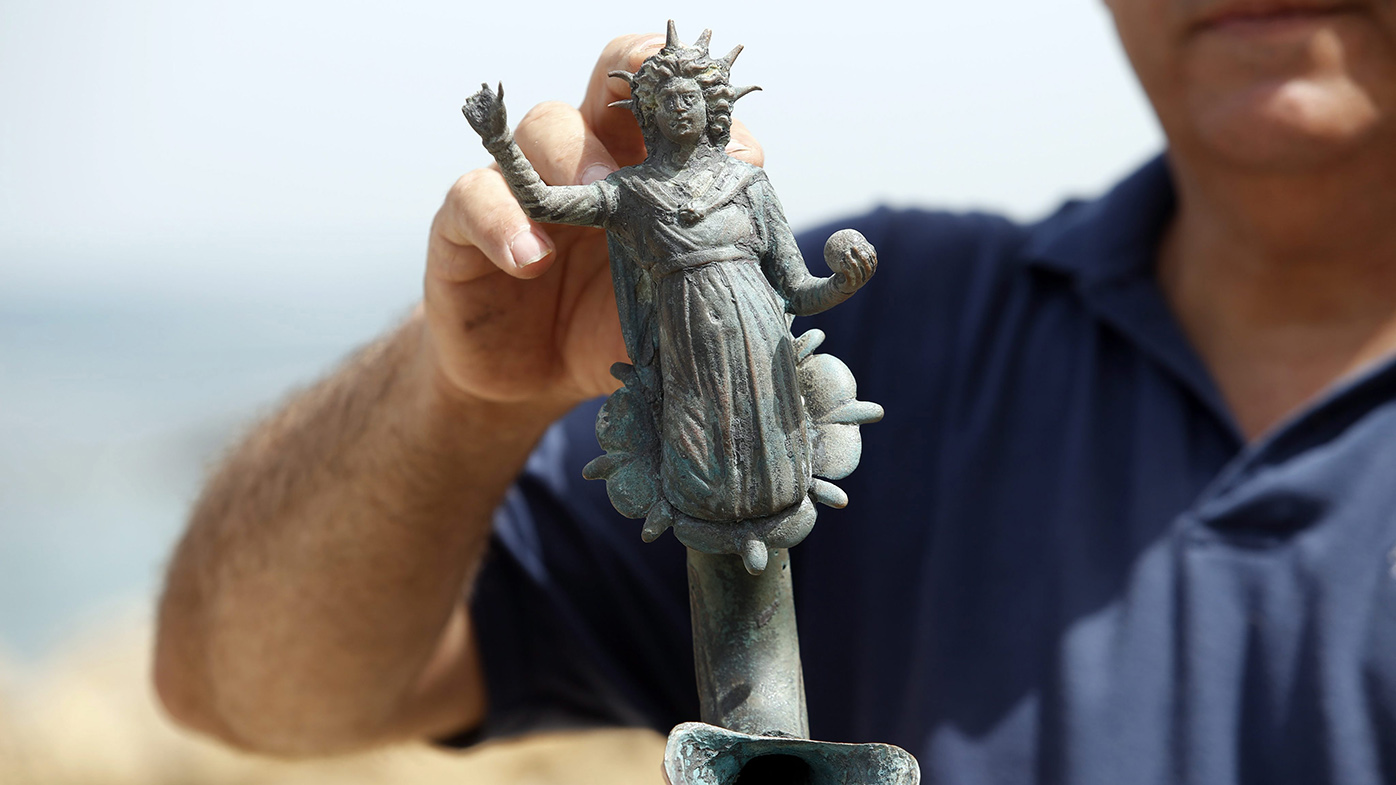 Jacob Sharvit, director of the Marine Archaeology Unit of the Israel Antiquities Authority displays one of the archeological finds. (AAP)