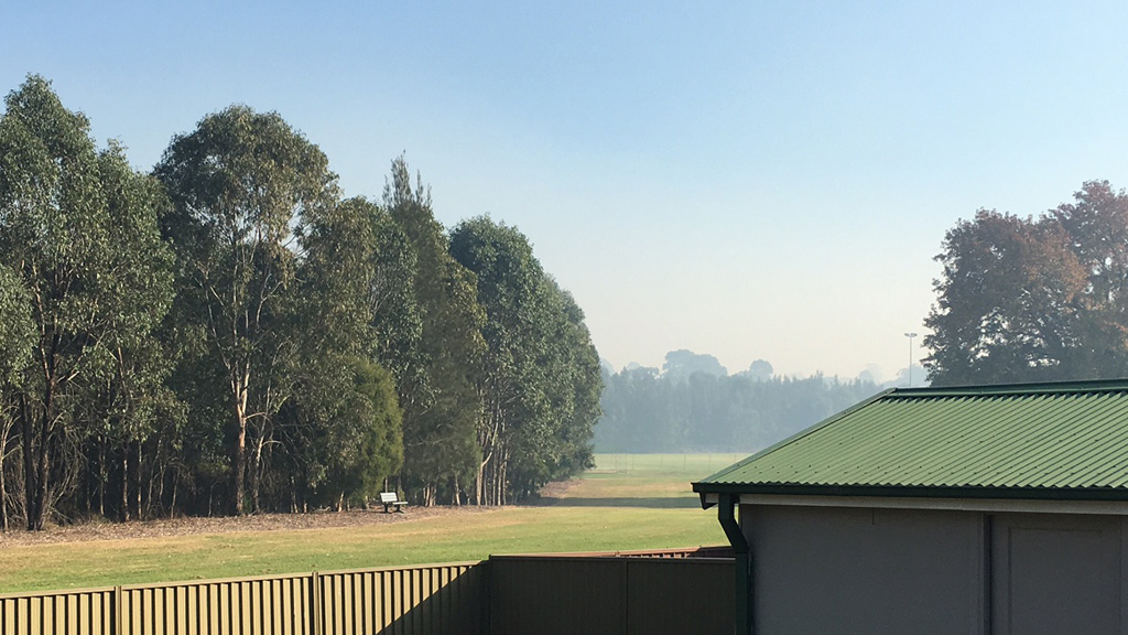 The smoke haze can be seen settled on the horizon at Lalor Park in Sydney's west. (Supplied: Rachel Spence)