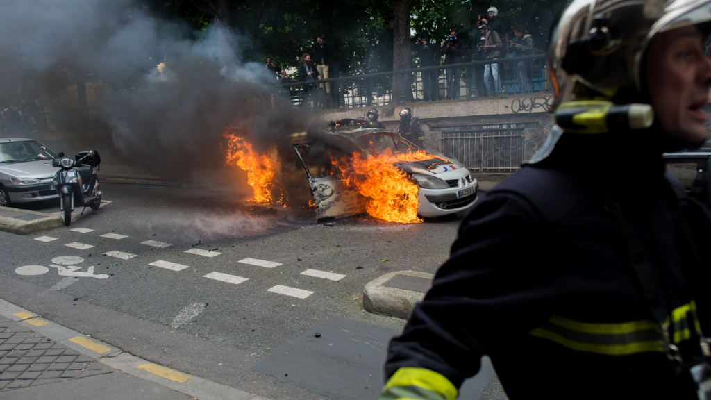 Police cars were torched at the rally. (AFP)