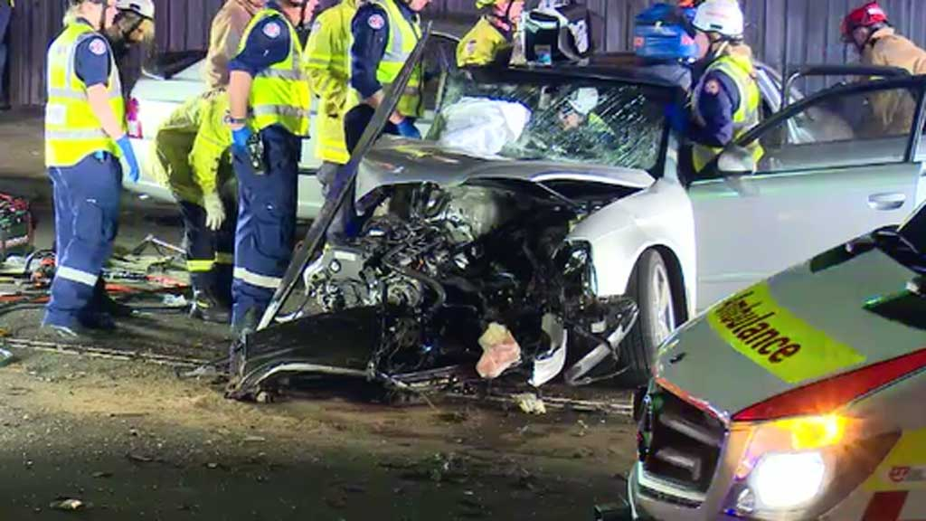 The street was closed while the car was removed. (9NEWS)