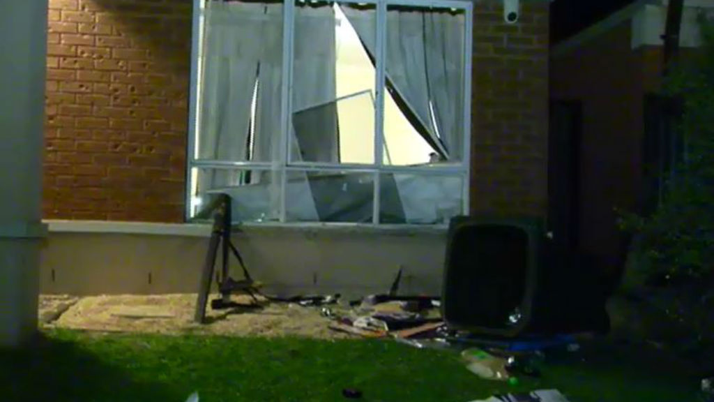 The gatecrashers the front windows of the property. (9NEWS)