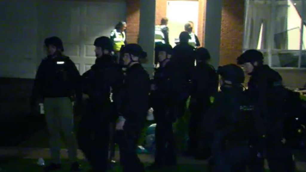 Police dressed in riot gear brought in the dog squad to assist. (9NEWS)