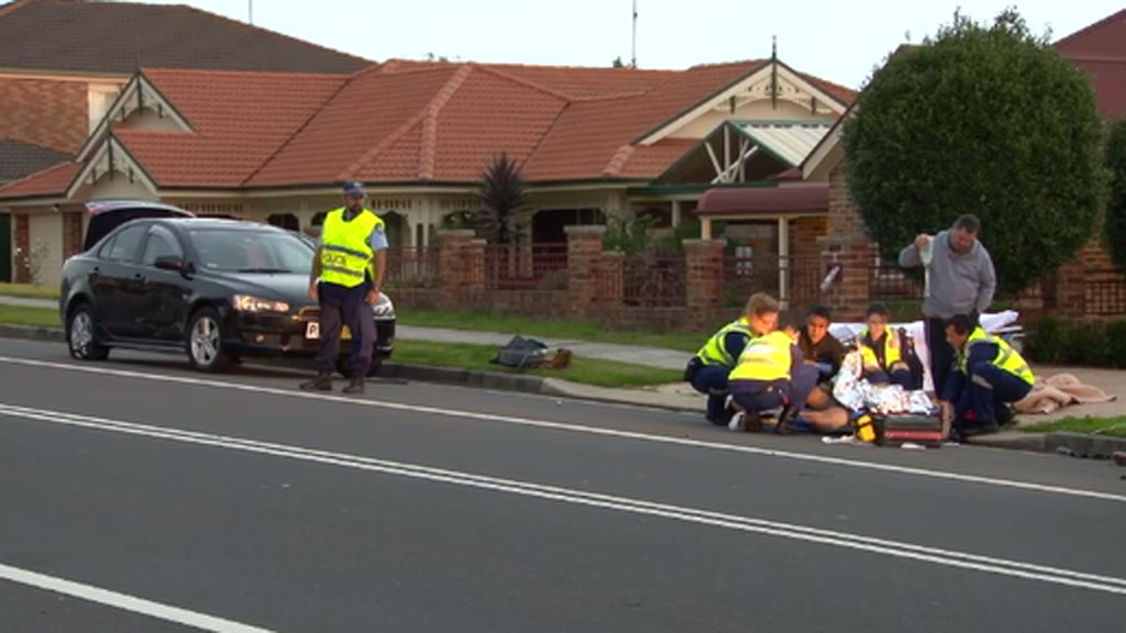 Man struck by car while changing tyre on Sydney road
