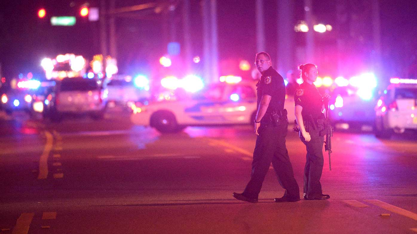 Police officers stand guard down the street during the Orlando nightclub shooting. (AP)