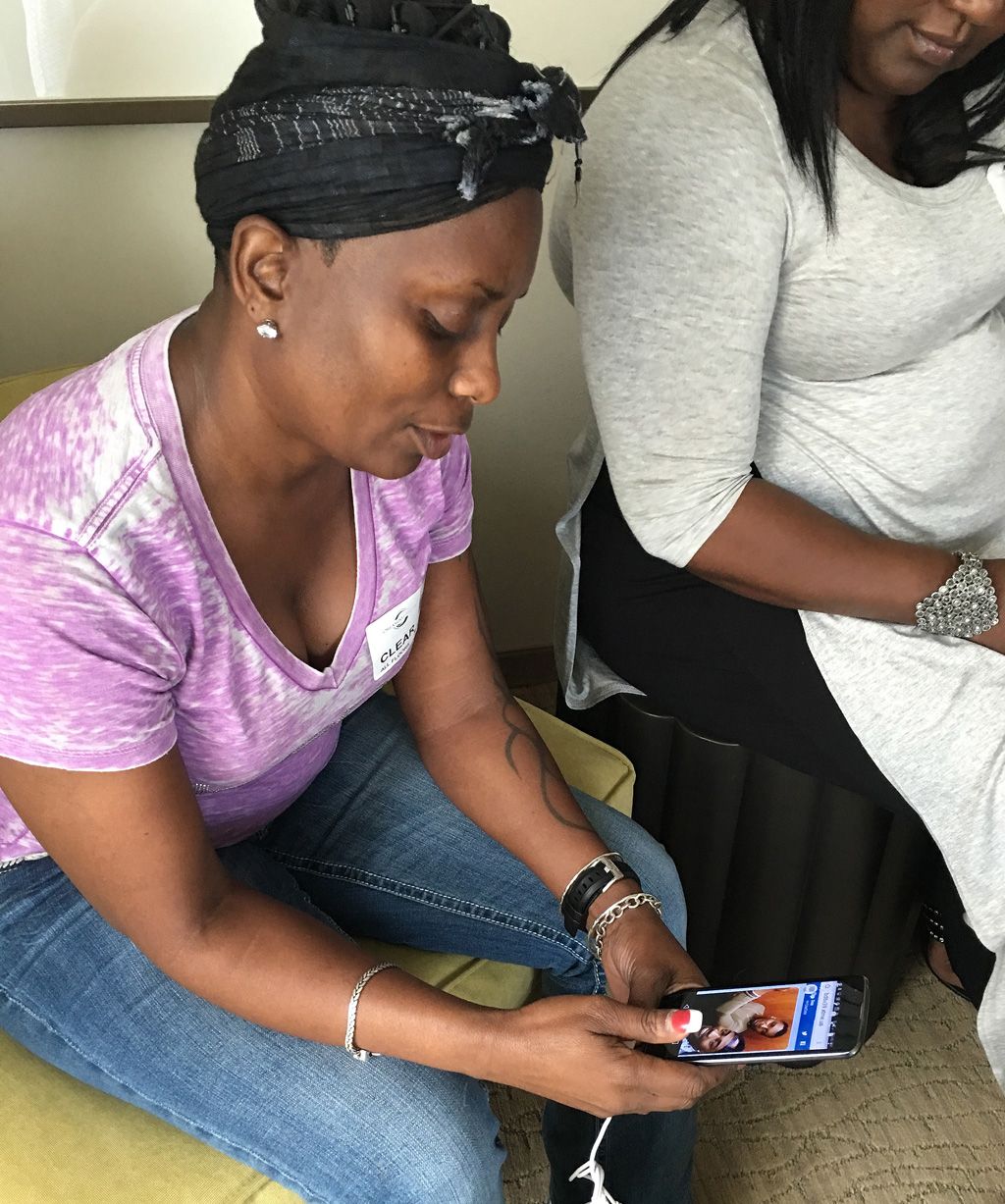 Mina Justice speaks to a reporter, discussing texting with her son Eddie Justice who was in a bathroom at Pulse during the shooting. (AAP)