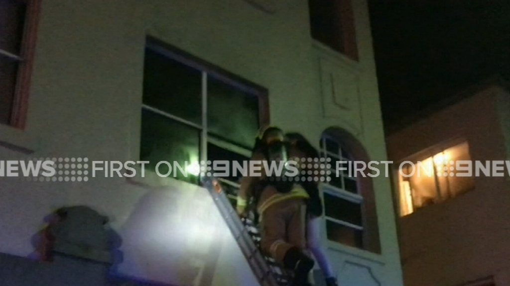 Firefighter rescues woman from Bondi Beach unit fire
