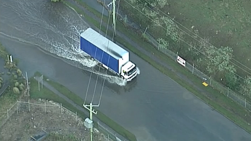 Some drivers ignored warnings about not driving through floodwaters. (9NEWS)