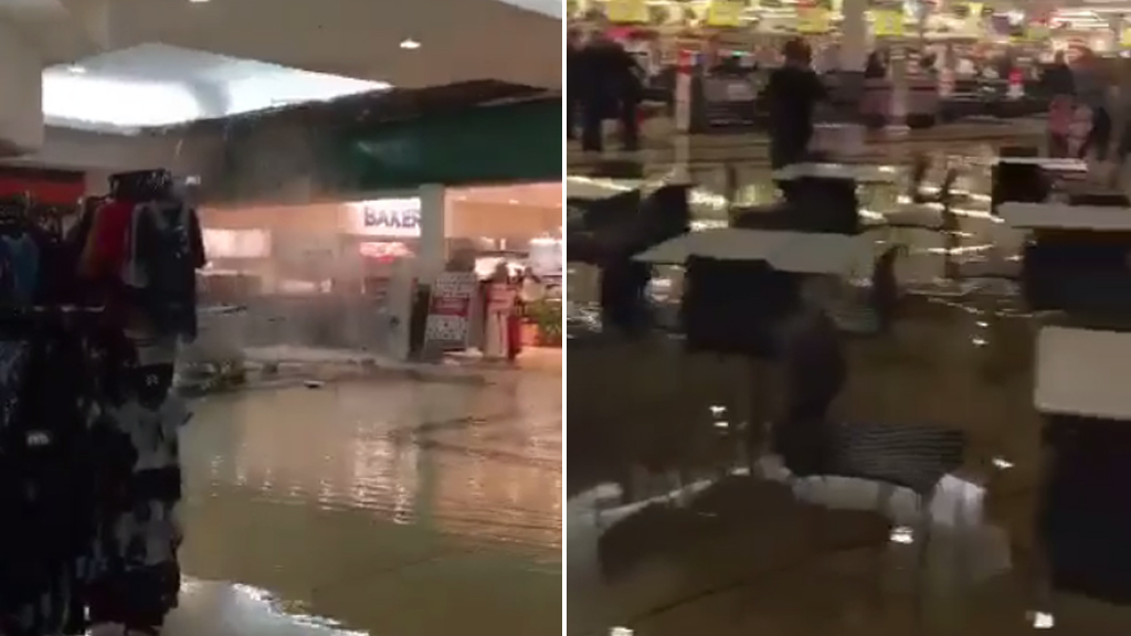 Sydney shopping centre evacuated as water gushes through ceiling