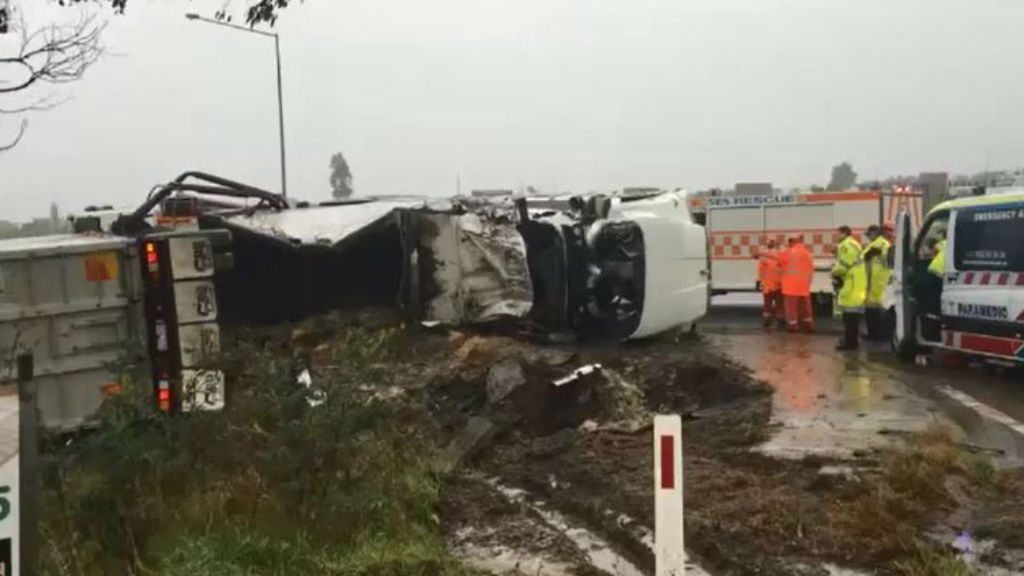 Driver hospitalised after truck rolled in Melbourne's north-west