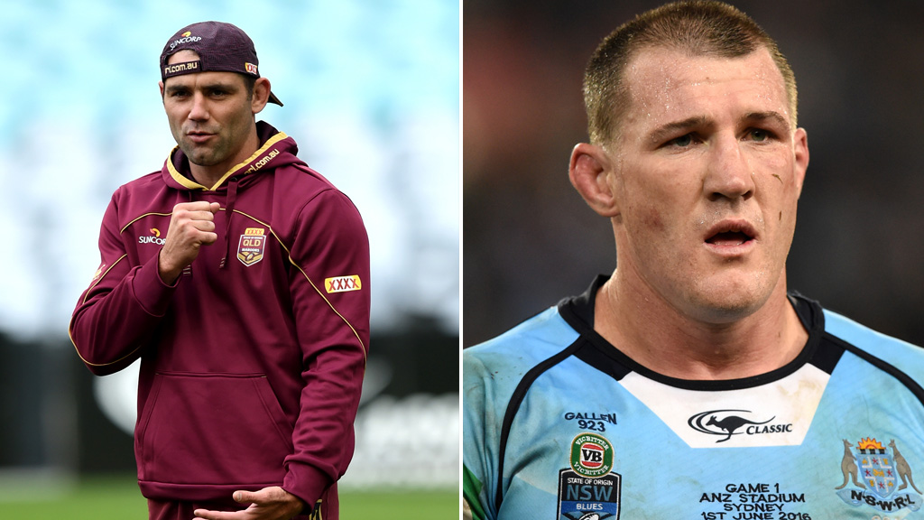 Captain Cameron Smith (left) will lead the Maroons against Blues captain Paul Gallen and the NSW side. (AAP)