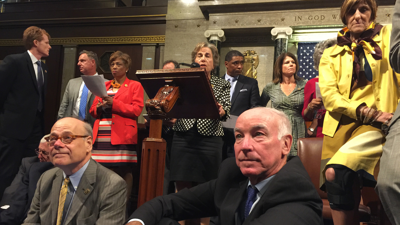 Dozens of US Democrats have staged a sit-in, chanting 'No bill, no break'. (AAP)