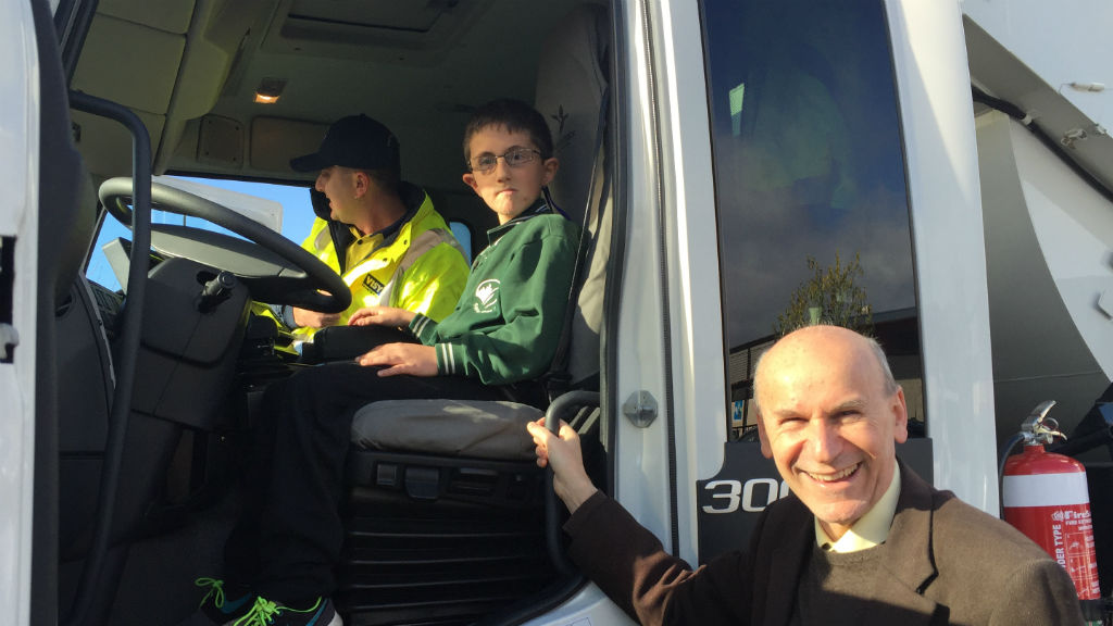 Arda in the truck with Jason (left) and Whittlesea Mayor Stevan Kozmevski. (Supplied)