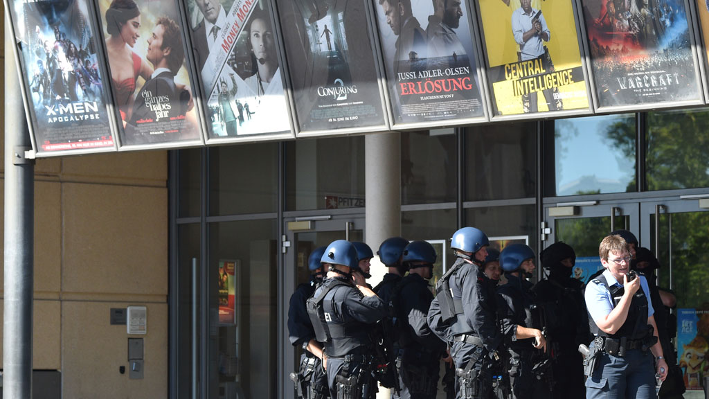Police forces stand in front of the German cinema (Getty)