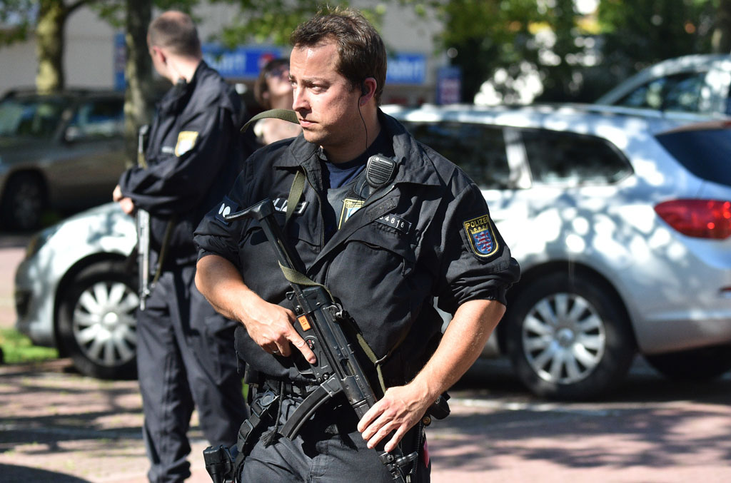 A Police man stands near a cinema where an armed man barricaded himself in Viernheim, southern Germany (Getty)