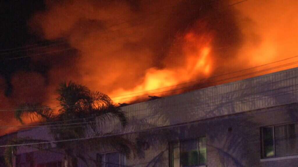 Flames were seen coming from the building's roof. (9NEWS)