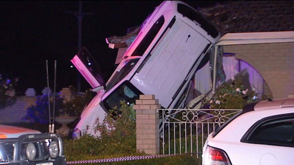 Airborne car almost lands on roof of house in Perth