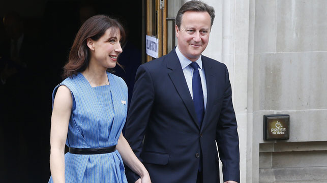 British MP David Cameron after voting with wife Samantha. (AAP)