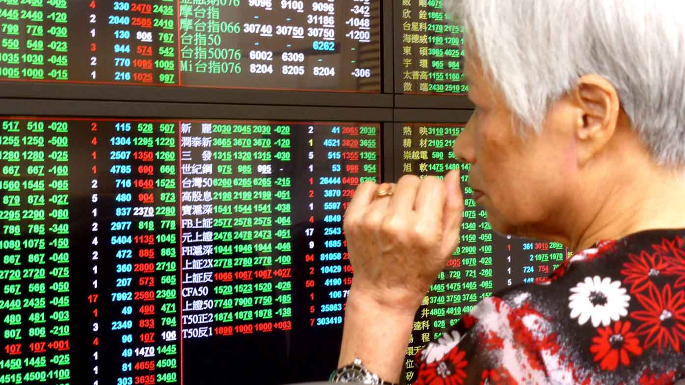 A woman anxiously surveys the market's reaction to the Brexit in Taiwan. (AAP)