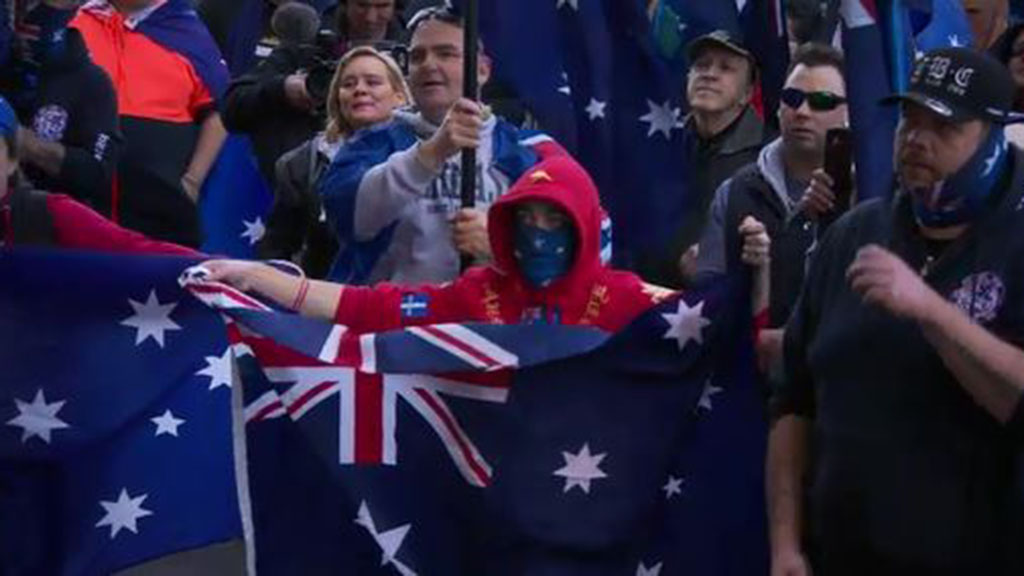 The move comes after violent rallies in Melbourne which saw masked protesters burn an Australian flag. (9NEWS)