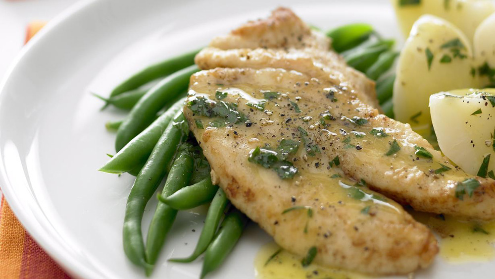 Fish with lemon butter sauce recipe nine kitchen for Lemon fish sauce recipe