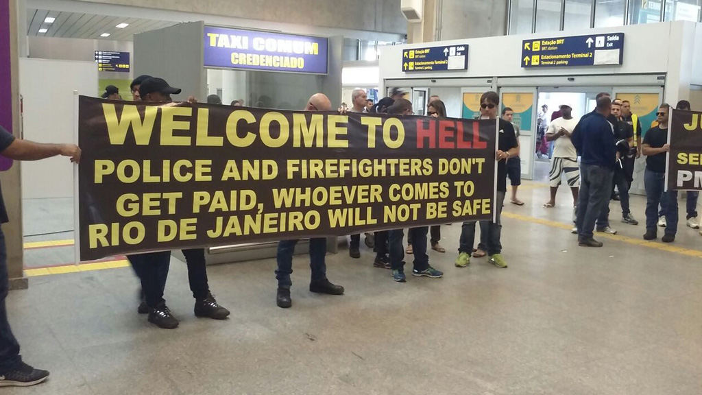 Rio visitors greeted with 'Welcome to Hell' banner at airport