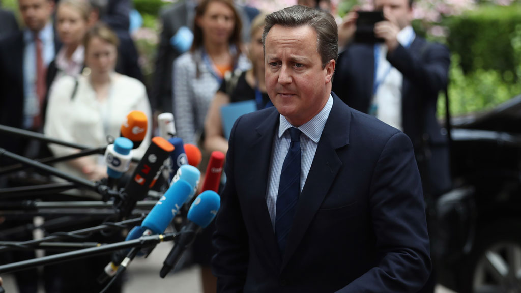 David Cameron faces reporters in Brussels (Getty)