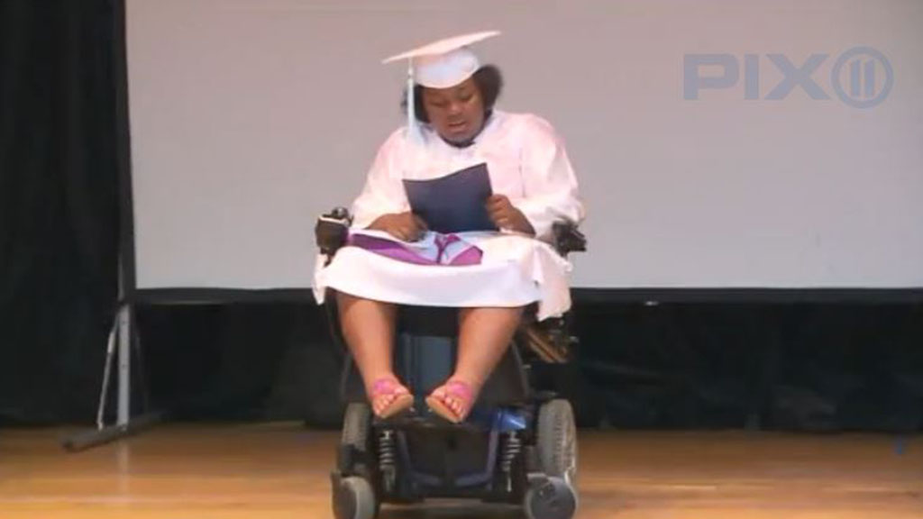 Teen shooting survivor receives standing ovation at grade eight graduation