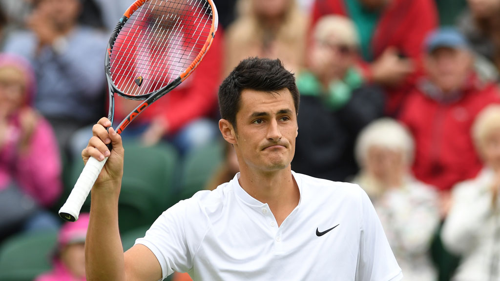 Bernard Tomic gets through to 2nd round at Wimbledon despite rain delays