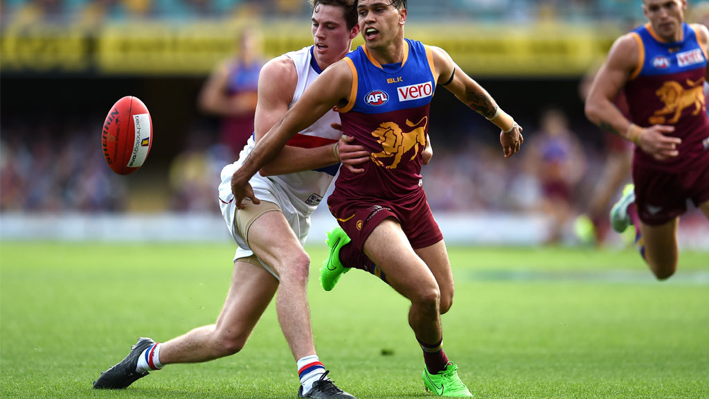 Zaine Cordy (left) of the tackles Allen Christensen of the Brisbane Lions. (AAP)