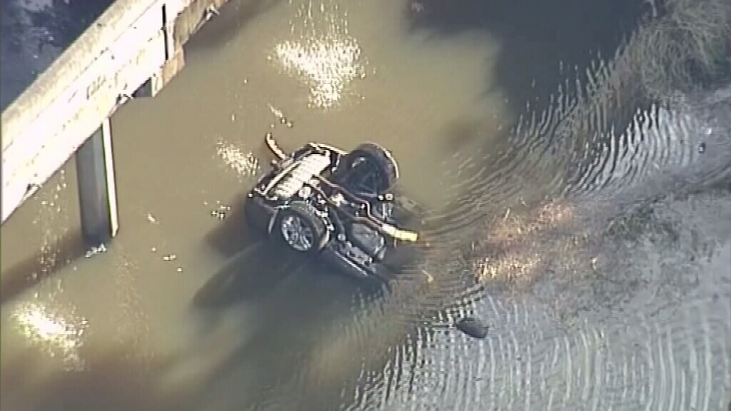 A vehicle fell from the truck into the water below. (9NEWS)