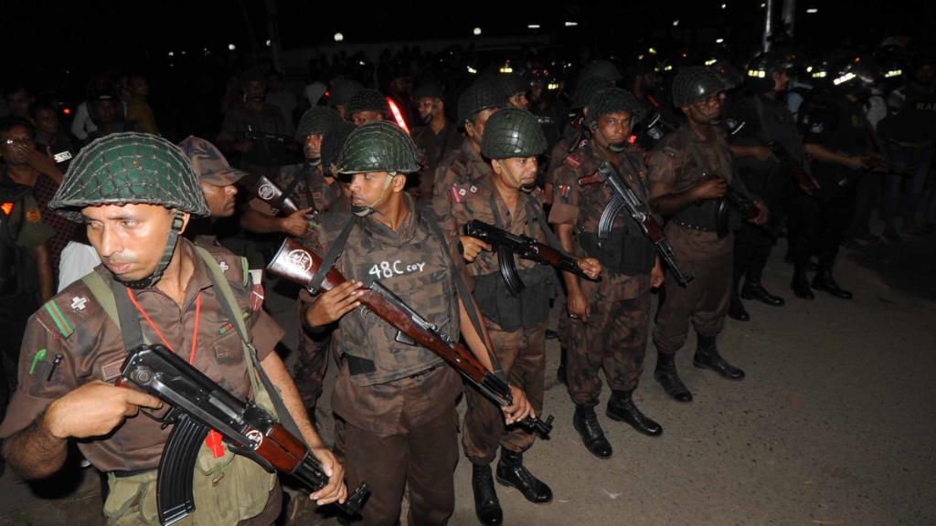 Authorities near the Dhaka restaurant. (AAP)