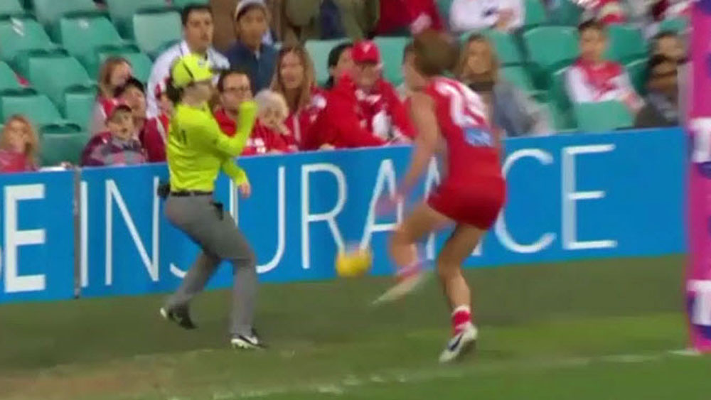 AFL: Swan saves goal umpire from painful accident