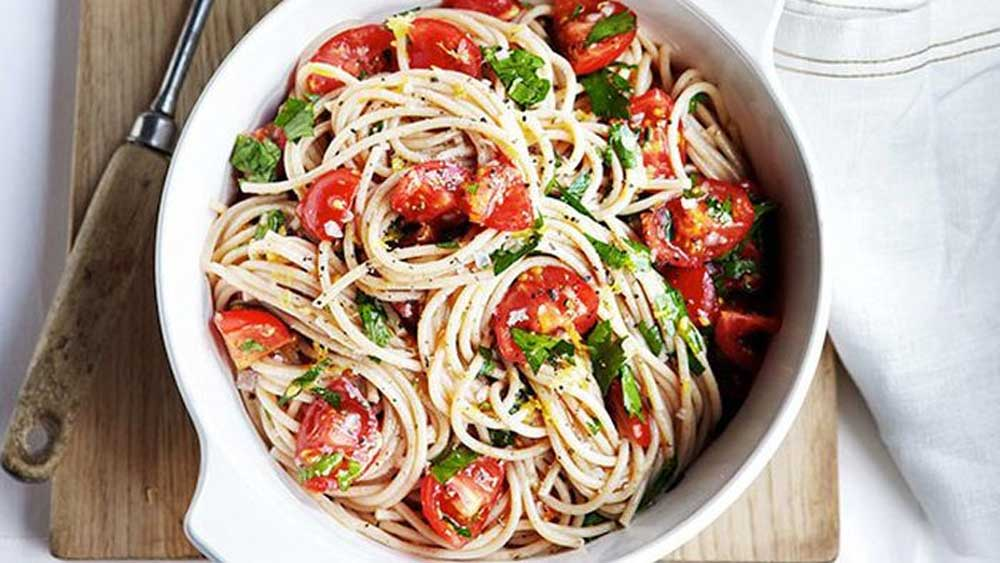 Buckwheat spaghetti with tomato, lemon and flat-leaf parsley