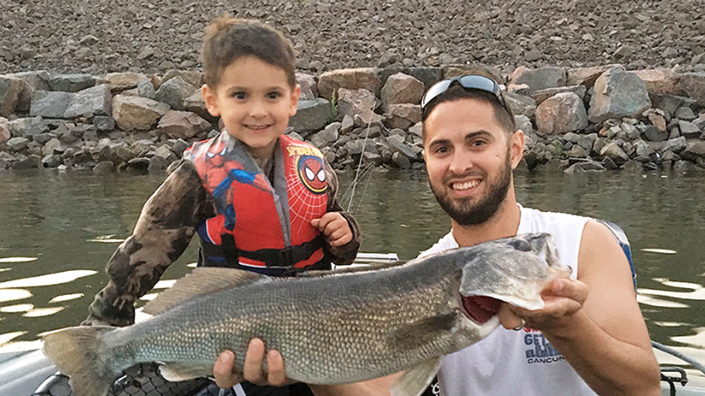 Tristan Evans, 4, and father Colin with their trophy-sized catch. (Colorado Outdoors Mag)